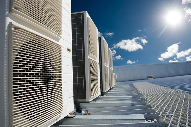 row of ac units on roof